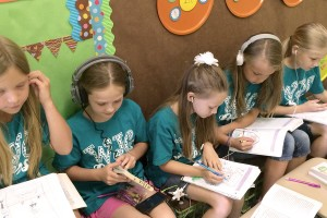 A Group Of Girls All Listening To The Lemonade War. They Are Using A Headphone Splitter And Each Have Their Own Set Of Headphones. They Love Drawing What They Hear In The Story, It Helps Make Those Mental Images Come To Life!